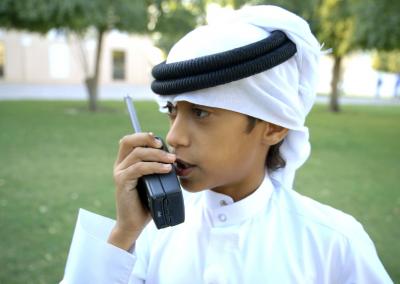 Qatar Investigators_boy w walkie talkie